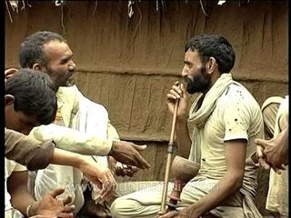 Old village man smoking Hookah in Rajasthan