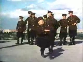 Сотрудники НКВД исполняют руские народные танцы.