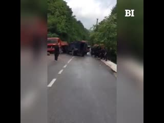 Kosovan police vehicle rams a truck off the road after barricades were put in place by citizens to stop kosovan police from ente