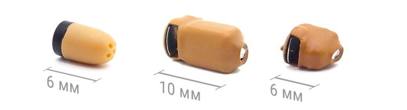 как беруши вставляются в ухо. В капсулу вставляется батарейка.