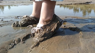 Girl in mud with her white KEDS extra length