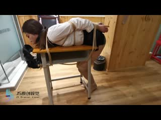 Asian Teacher Suspended and Table Tied