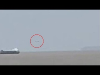 Huge Silver UFO Filmed Hovering Near Ship On The Bristol Channel In The United Kingdom. May 18, 2020